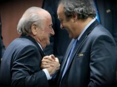 Sepp Blatter en Michiel Platini fifa schandaal getty